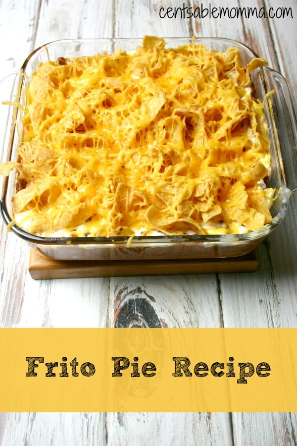 Cold weather = comfort food like this easy-to-make Frito Pie recipe. It includes a base of chili (with taco seasoning) and it's topped with sour cream, Fritos, and shredded cheese.
