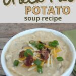 potato soup in a white bowl topped with bacon, cheese, and chives with text overlay.