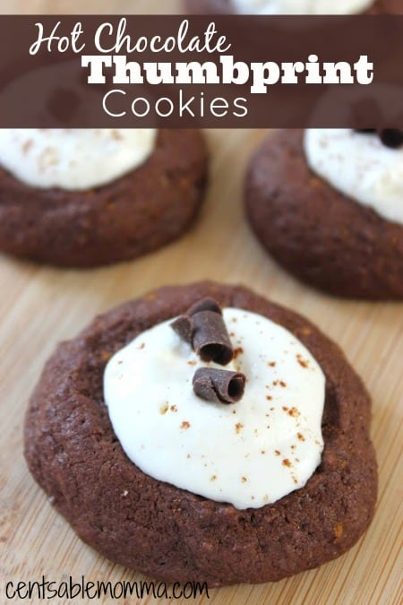 You'll be thinking about sitting down with a nice cup of hot chocolate on a cold winter day with each bite of these Hot Chocolate Thumbprint cookies - with hints of cocoa and vanilla.