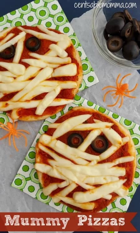 Do you need an idea for a Halloween party food? Try this Mummy Pizza bites recipe made with biscuits (although you could use English Muffins or rolls if you prefer), pizza sauce, string cheese, and black olives. It's easy to put together for a Halloween dinner/snack, and you can even have the kids put them together themselves
