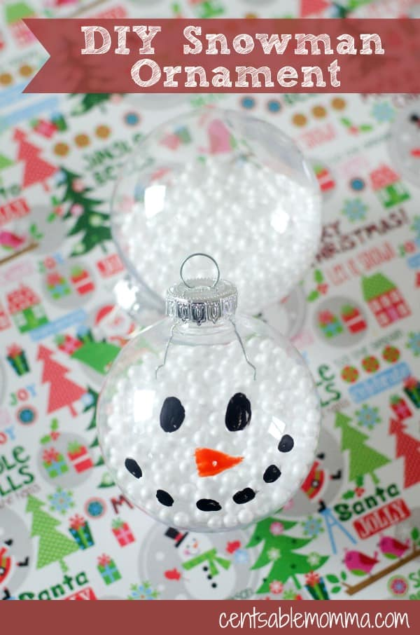 Easily create this DIY Snowman Ornament as a Christmas craft with kids or as a fun gift for others.  All you need is a clear ornament, faux snow, and some acrylic paint!
