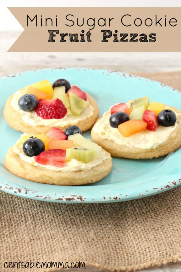 Easily create a healthier version of the regular sugar cookies with this Mini Sugar Cookie Fruit Pizzas recipe.  Made with fresh fruit, fruit dip, and store-bought sugar cookie dough, they're a delicious treat!