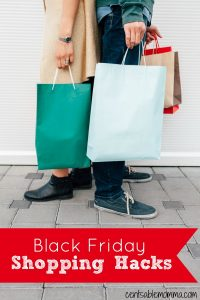 man and woman standing back to back holding shopping bags