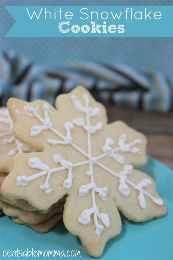 These White Snowflake Cookies are perfect for the holidays!  It's a basic sugar cookie recipe with snowflakes outlined and decorative edible pearls as an accent.  They are both a delicious dessert and perfect for your Christmas party.