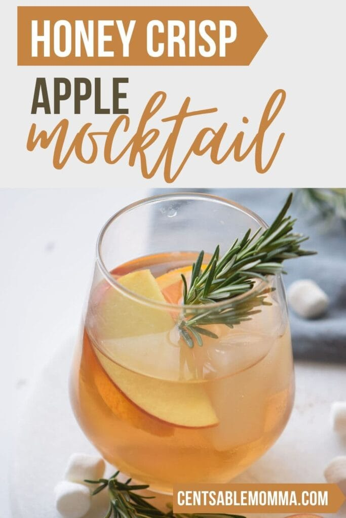 honey crisp apple mocktail in a glass with garnishments and text overlay.