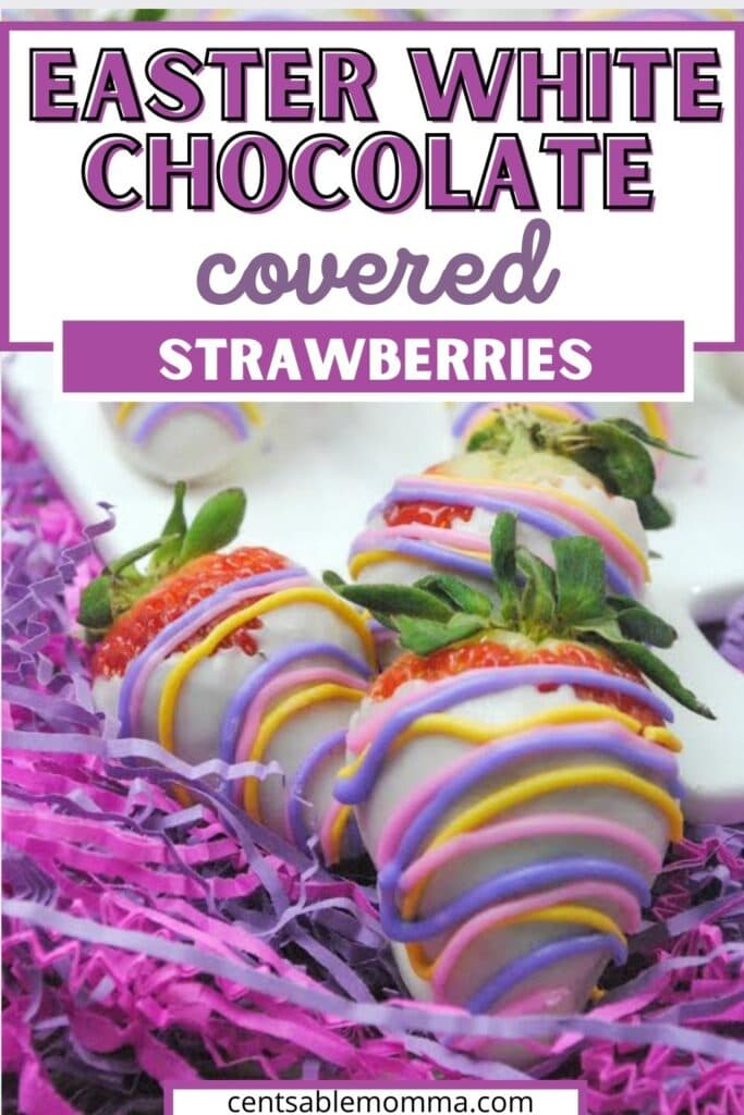 Three white chocolate covered strawberries drizzled with pastel colors and placed on purple strips of paper and a white plate.